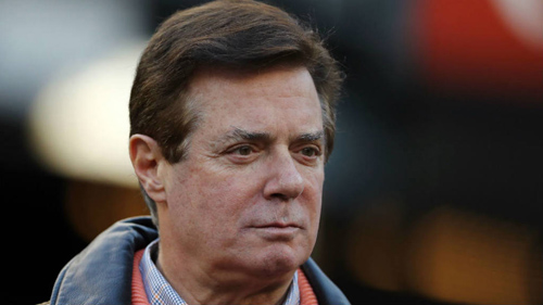 Manafort indicted on 12 counts, surrenders to FBI