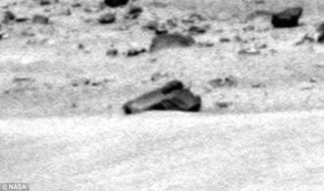 Is there a pistol on the red planet? Conspiracy theorists claim to have spotted hand gun on Martian surface