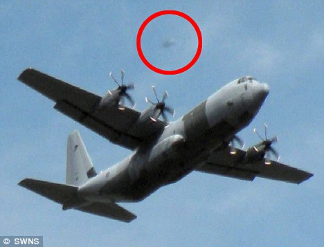 Retired school teacher captures UFO 'stalking' RAF Hercules on camera