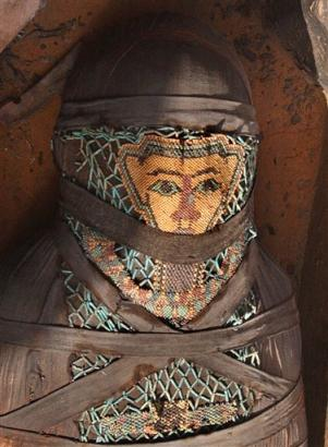 Archaeologists Uncover Bead-Covered Mummy