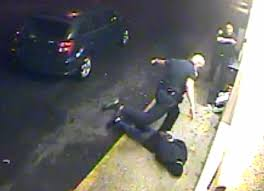 Disturbing Video Catches Cop Severely Beat Restrained Man & Threaten Him With Gun to His Head