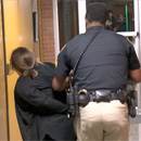 Photo: Teacher handcuffed, removed from school board meeting after asking about teacher pay