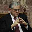 Former Greek Prime Minister Lucas Papademos has been injured by an explosion inside his car in Athens