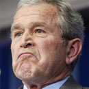 President Bush reacts to a reporter's question
