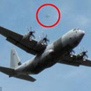 Photo: Retired school teacher captures UFO 'stalking' RAF Hercules on camera