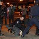 Photo: Police fire tear gas at Oakland, 200 arrested