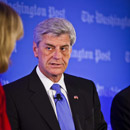 Photo: Mississippi governor signs law allowing businesses to refuse service to gay people