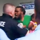 Photo: Mob of Philly cops assault man holding crying baby for not paying his $2.25 transit fare