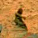 "Photo: Female Figure on Mars ""Just a Rock"""